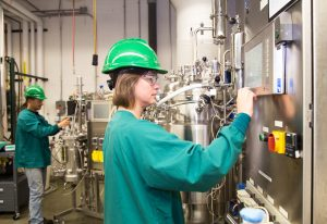 Woman working on scale up plant