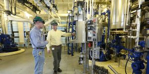 Two employees working in chemical manufacturing plant