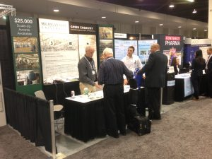 Team members working at trade show booth