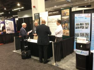 People networking at a trade show booth