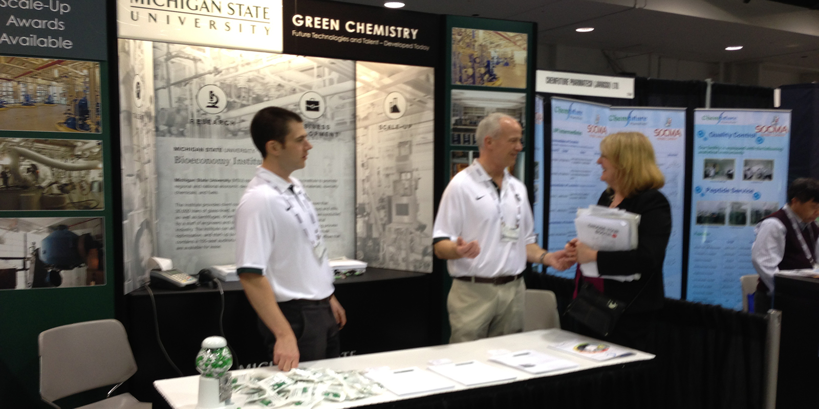 MSU BI staff at trade show booth