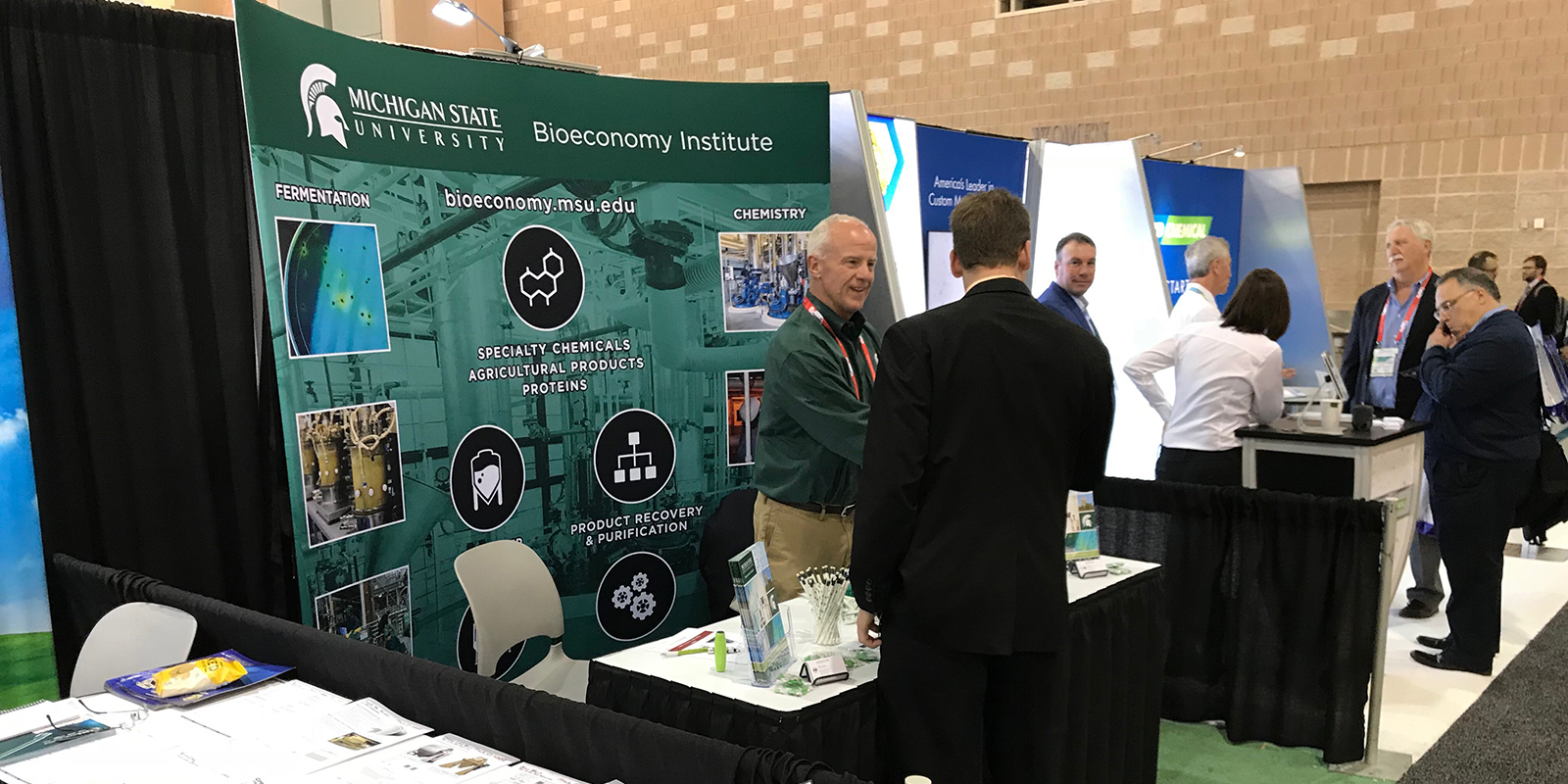 Freckman greets guests at trade show booth