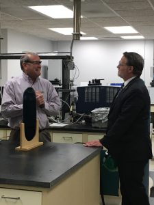 Senator Peters speaking to Dr. Tom Guarr in his research lab