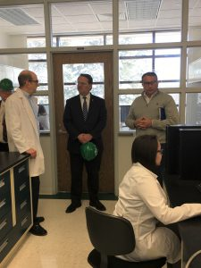 Senator Peters speaks with staff at Trident Labs