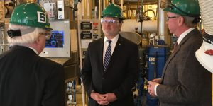 Senator Gary Peters and others during a tour of scale up plant