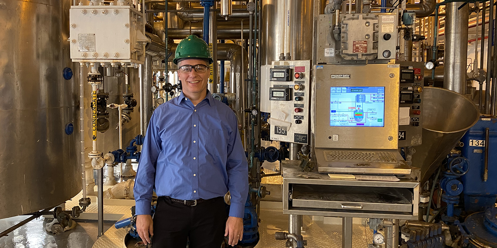 Doug Heemstra in hard hat in the scale up plant
